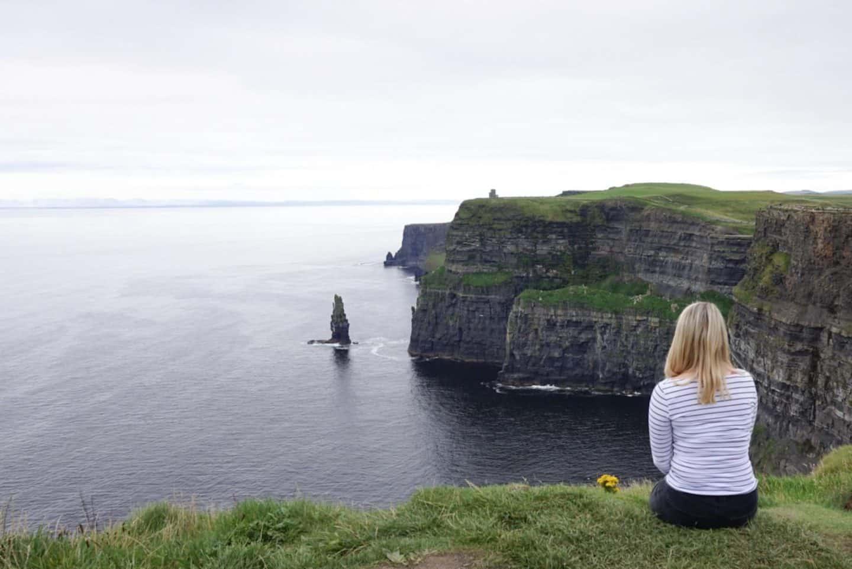 blonde girl cliffs of moher west coast ireland